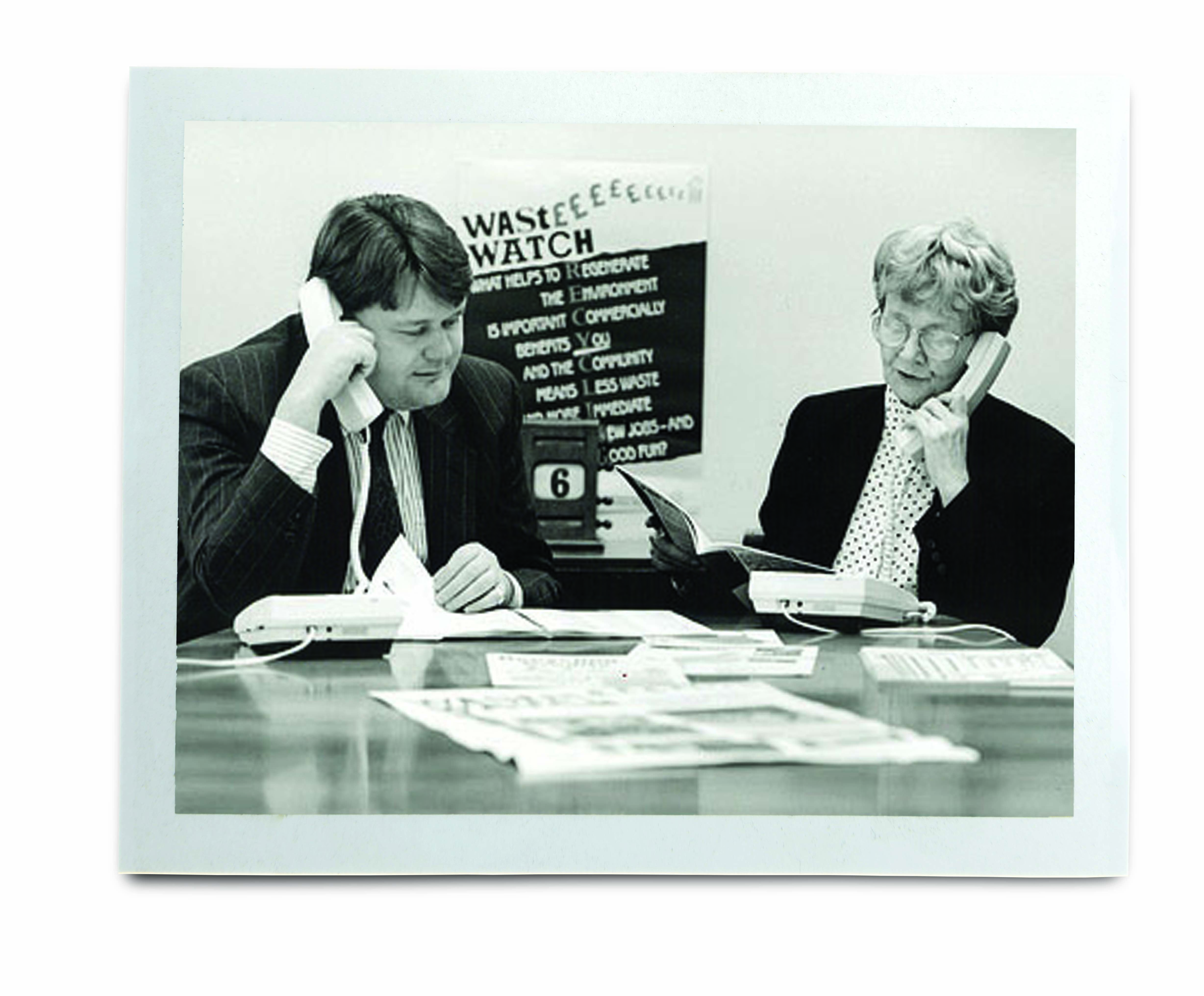 An image of two people on the phone