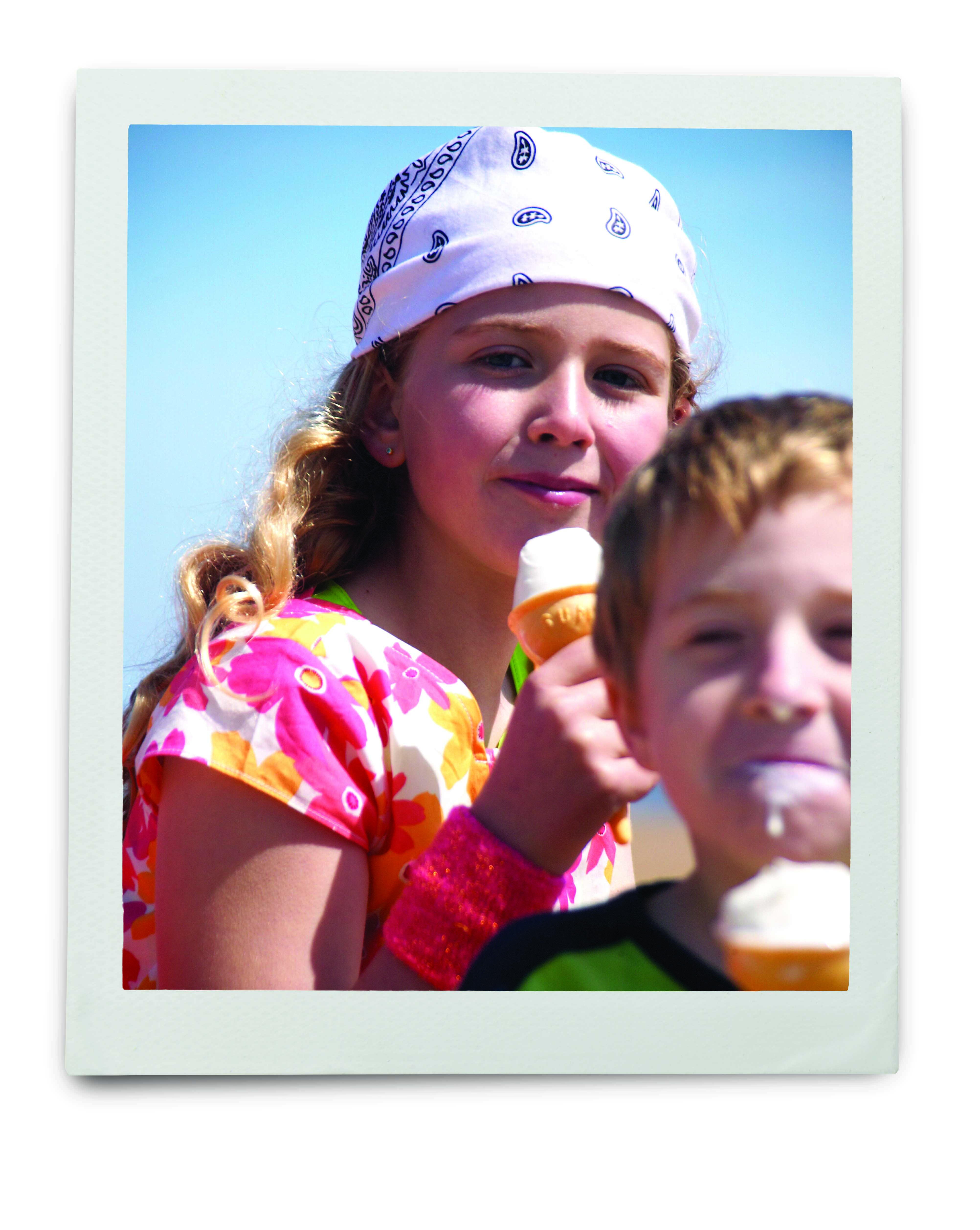 An image of a young girl and boy eating ice cream