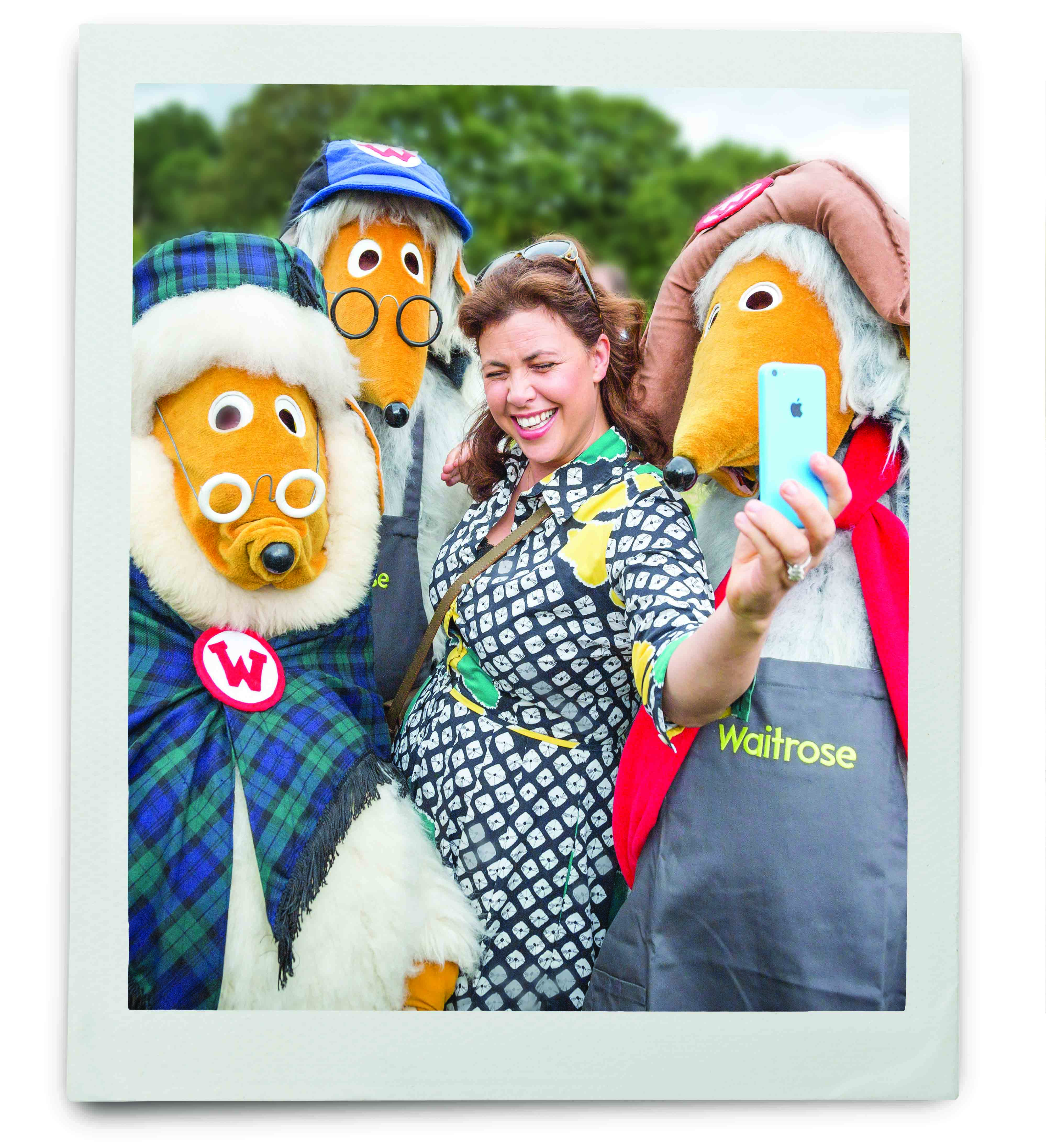 An image of Kirsty Allsop taking a selfie with three people in Wombles costumes