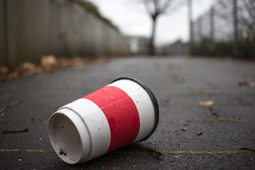 An image of a littered coffee cup