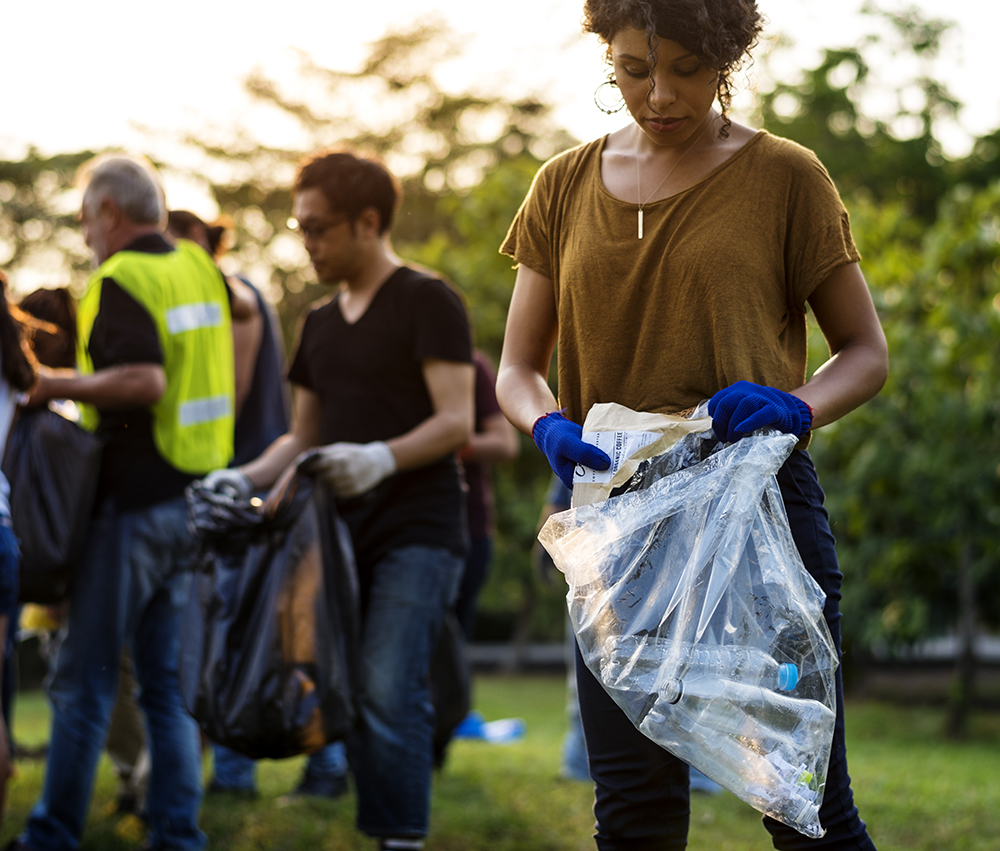 An image of a group picking up litter